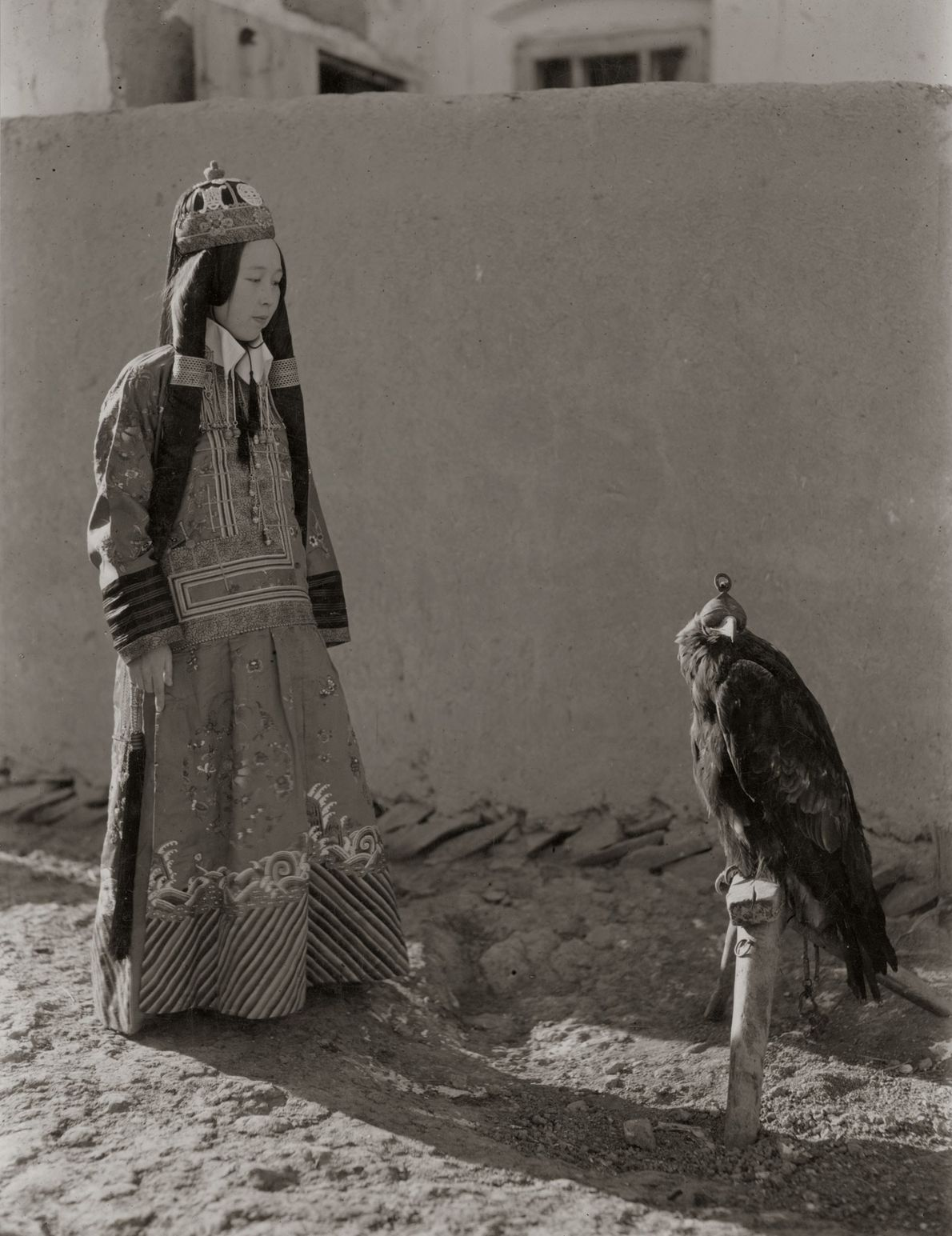 Chinese Princess Nirgidma stares down her eagle in 1932.