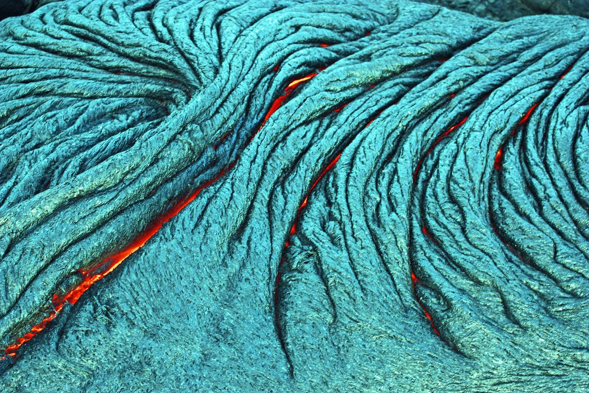 Active pahoehoe lava flows, like the one seen here, are produced by superheated flowing magma.