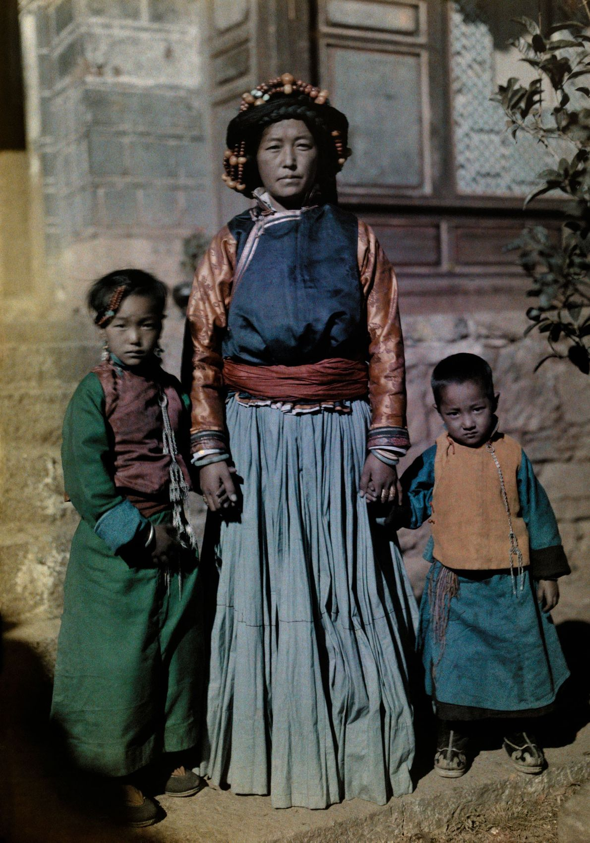 The queen of Nyorophu stands with two of her children on Nyorophu Island in the Yunnan ...