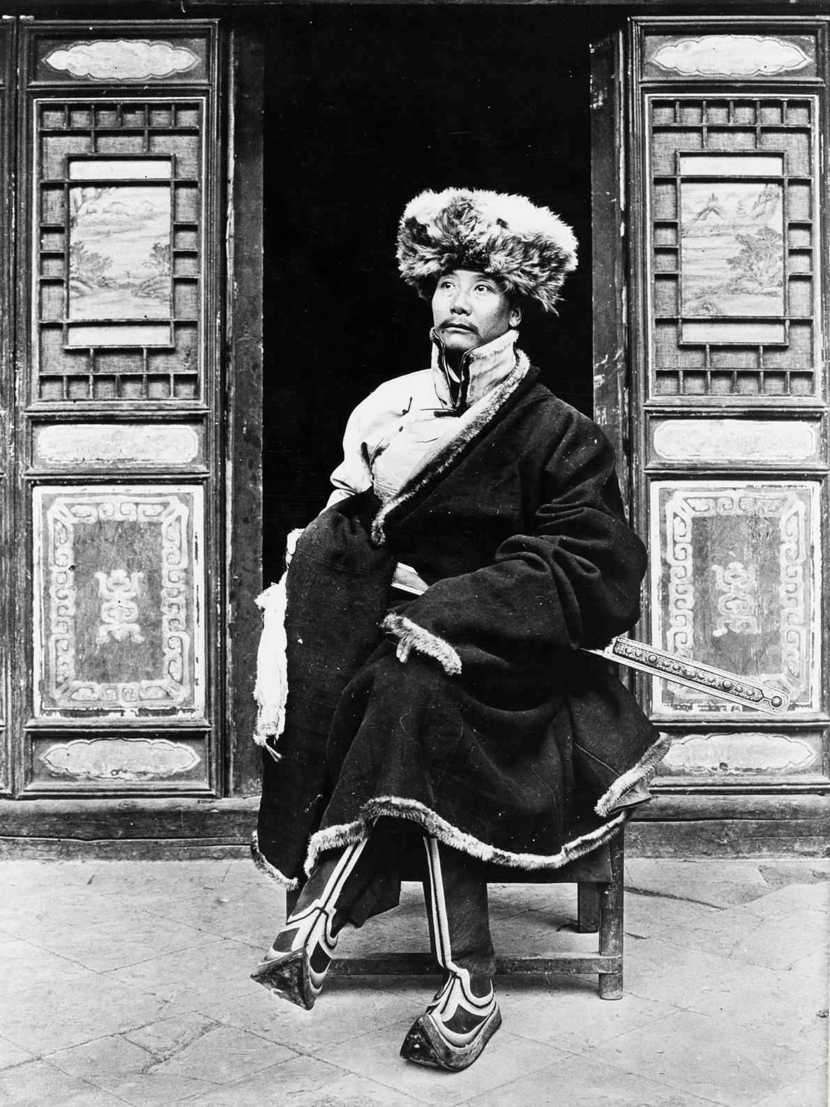 Yang-Chi-ching, the prince of Liulin in the Gansu Province of China, sits in front of his ...