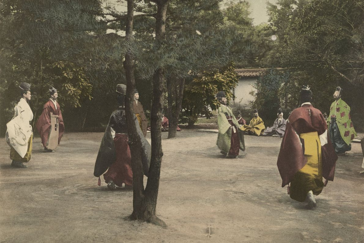 A group of nobles in Kyoto, Japan, play Shukyu, a traditional sport similar to football.  ...