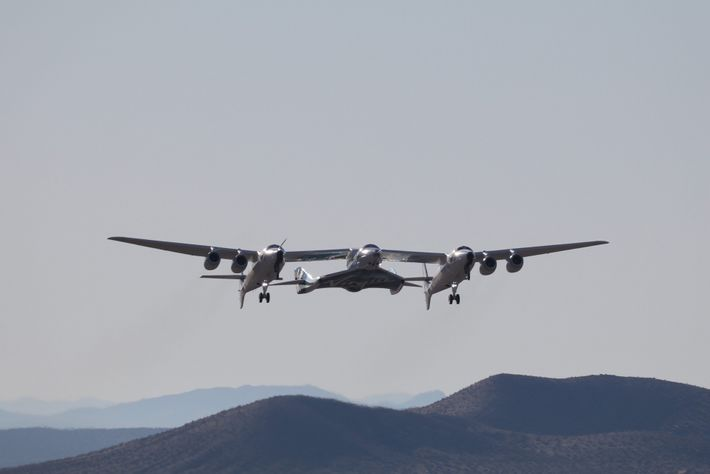 Virgin Galactic reaches space by first sending the SpaceShipTwo vehicle into the air attached to a ...