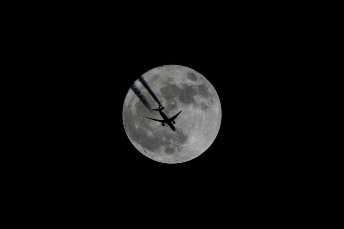 An aircraft flies in front of the supermoon in Van, Turkey.