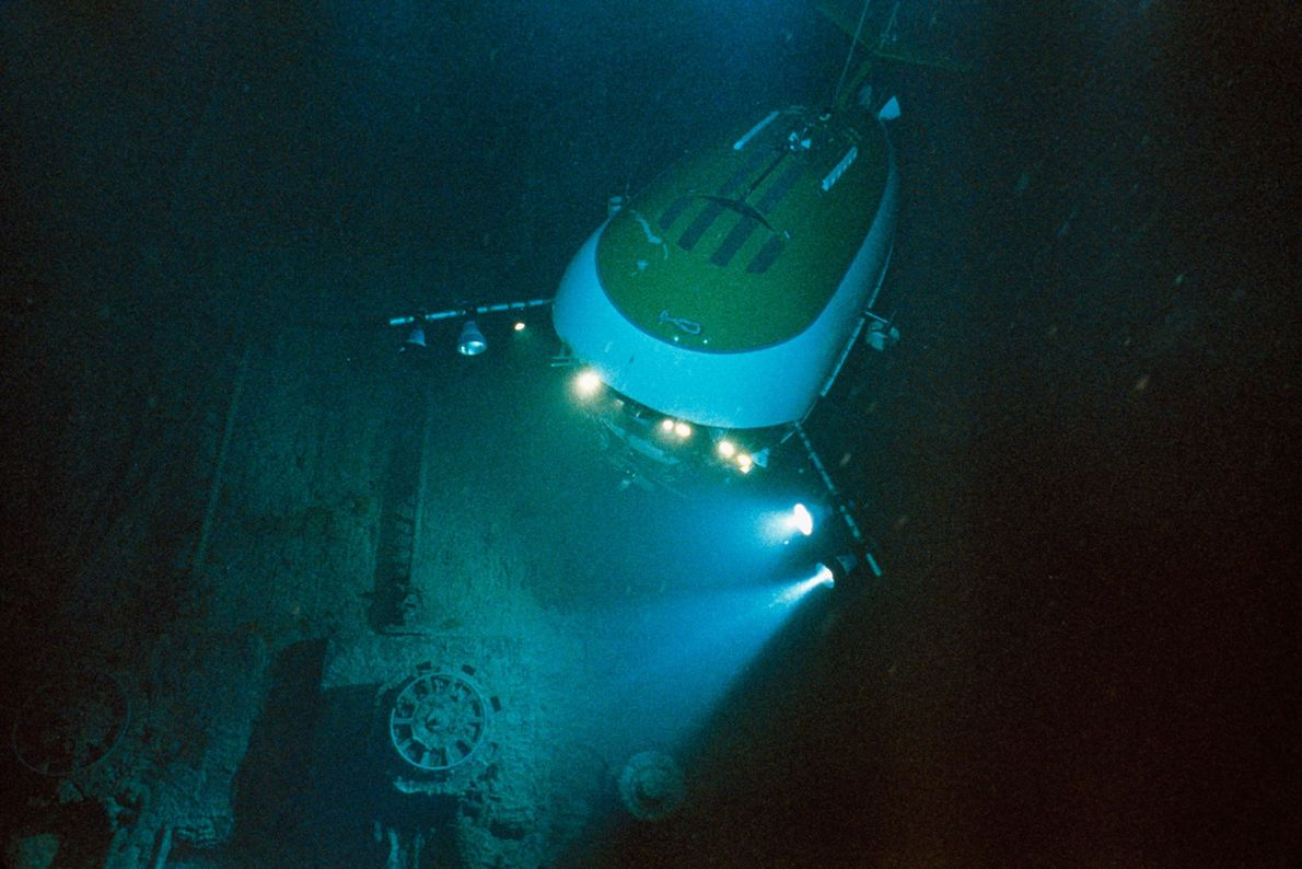 Lights from a Mir submersible, a deep-sea vehicle with room for three people, expose the Titanic's ...