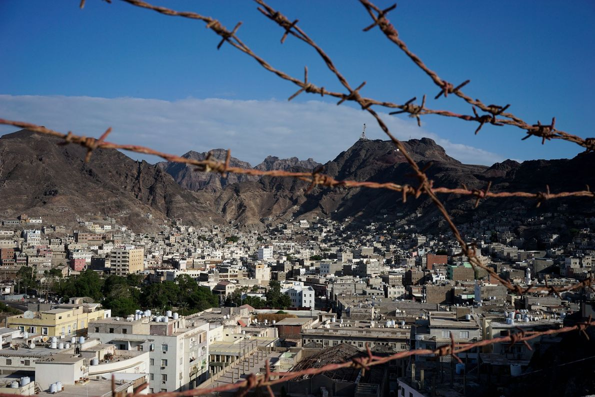 Barbed wire cuts across a picturesque vista of Yemen's port city of Aden. After the capital ...