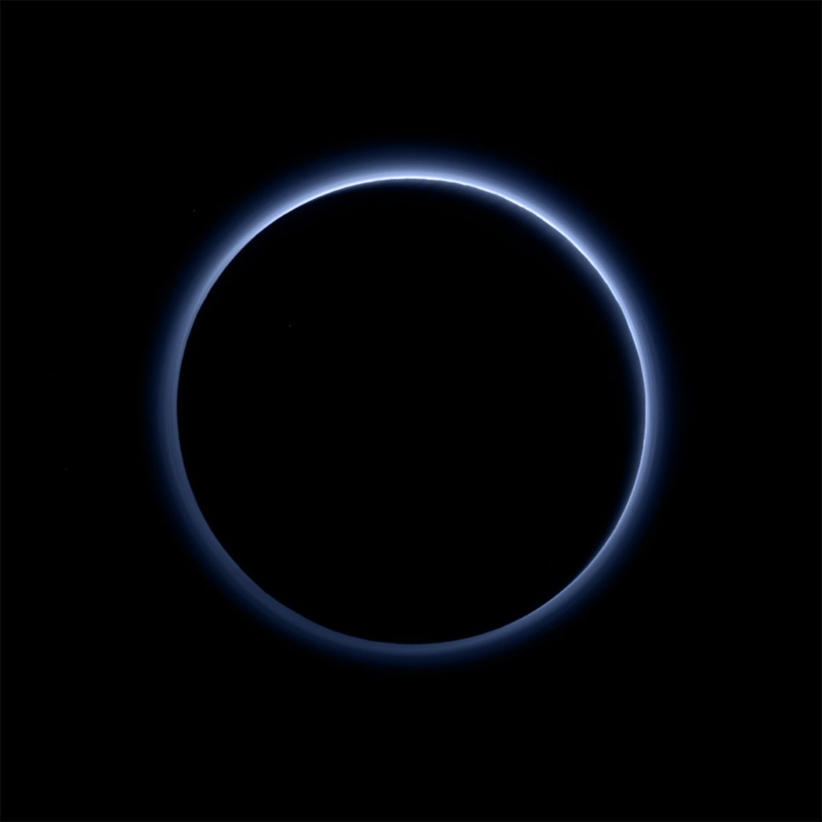 New Horizons took this picture of Pluto with the sun directly behind the dwarf planet, revealing ...