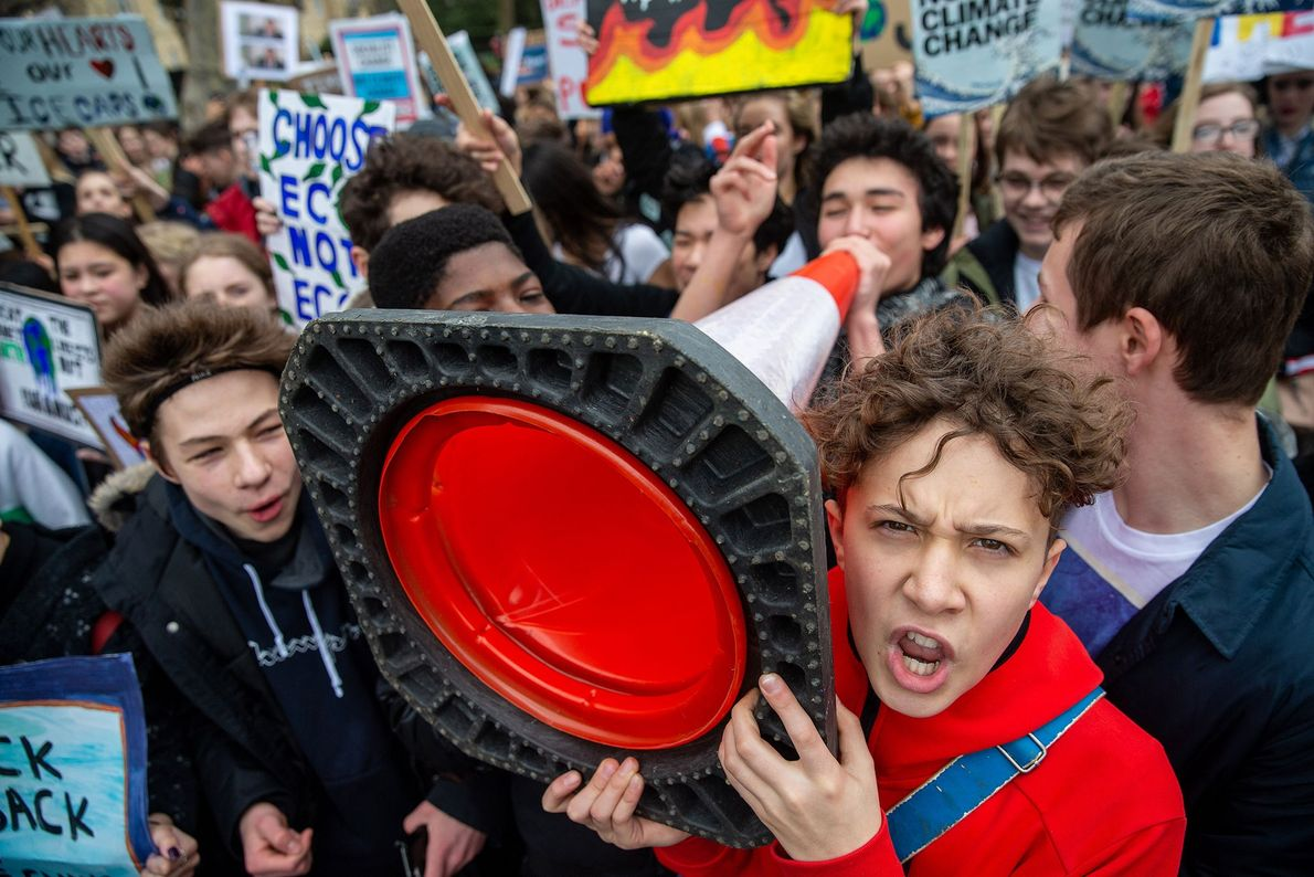 Other students in London gathered outside Buckingham Palace, demanding that elected officials take action on climate ...