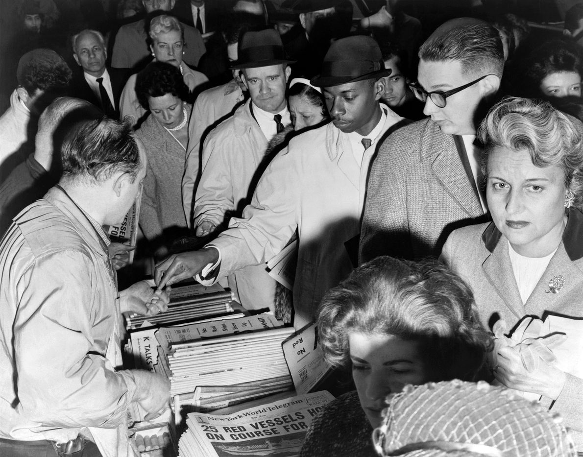 New Yorkers eager for news of the Cuban crisis line up to buy newspapers, New York, ...