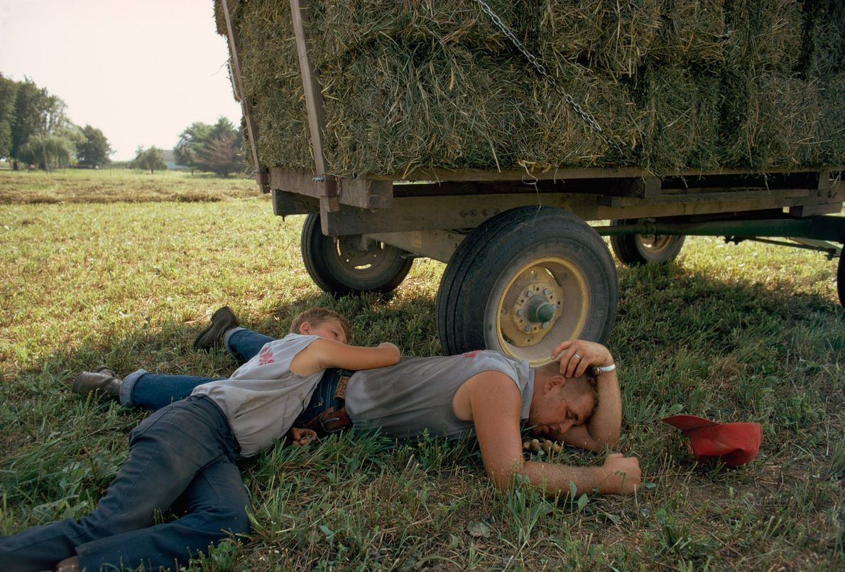 Farmers rest by their truck after loading straw in Delaware County, Iowa.