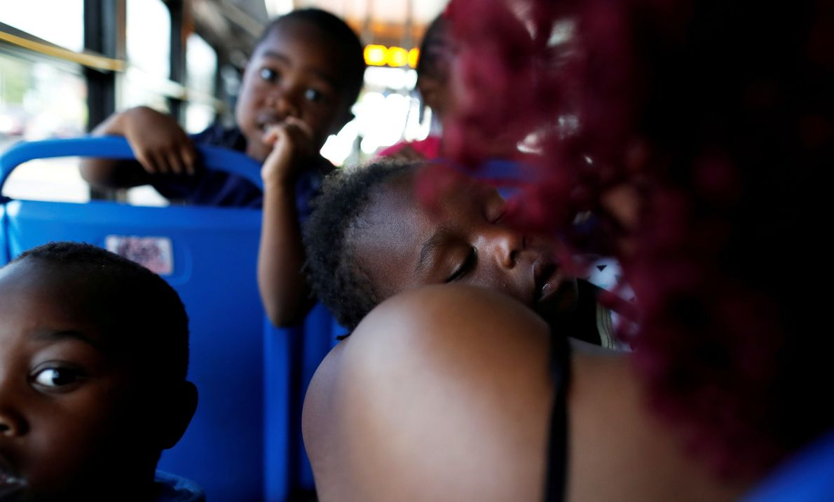 Latonya Willis of Wilmington, North Carolina holds her 17 month-old son Ayden with her other children ...