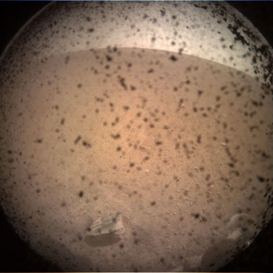 NASA's InSight lander sent back its first picture of the Martian surface just moments after touching ...