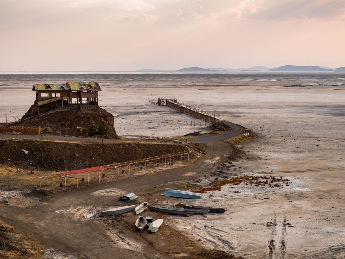 Empty buildings and abandoned boats are all that remain at Rahmanlu Port. When the lake was ...