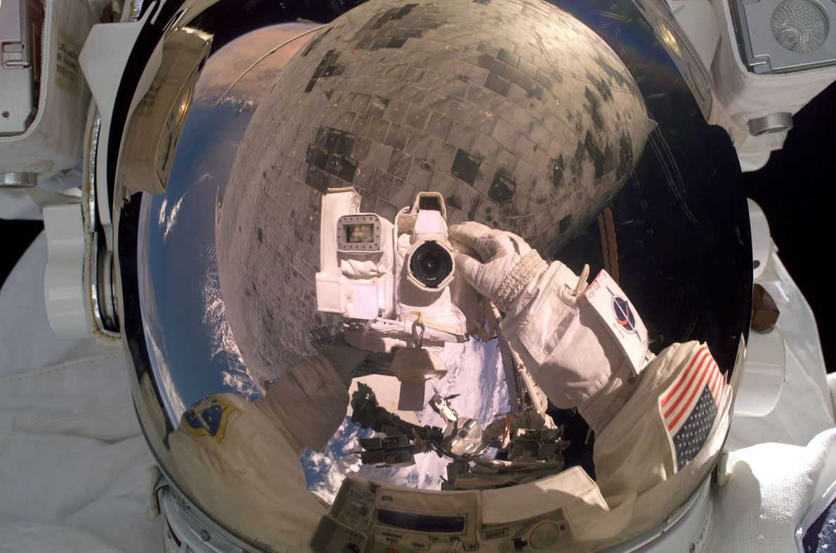 Astronaut Steve Robinson turns the camera on himself during a historic repair job on the underside ...