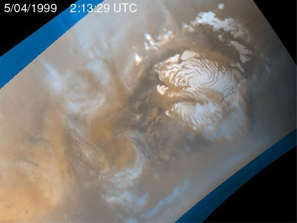 Mid-summer days on Mars heat the red planet's surface, turning ice into wispy clouds that are ...