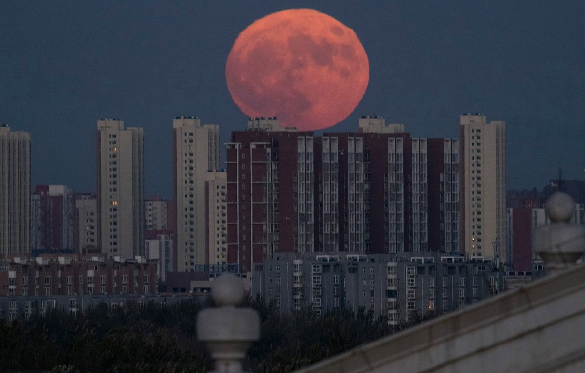 A supermoon rises behind apartment buildings in Beijing, China, in November 2016.