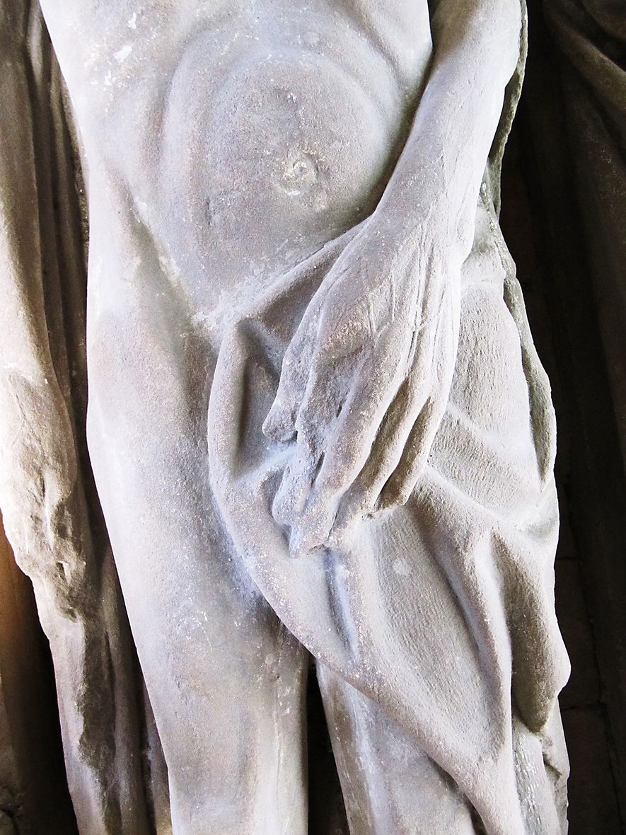 The carved cadaver of an unidentified man covers himself for modesty at the Church of St. ...