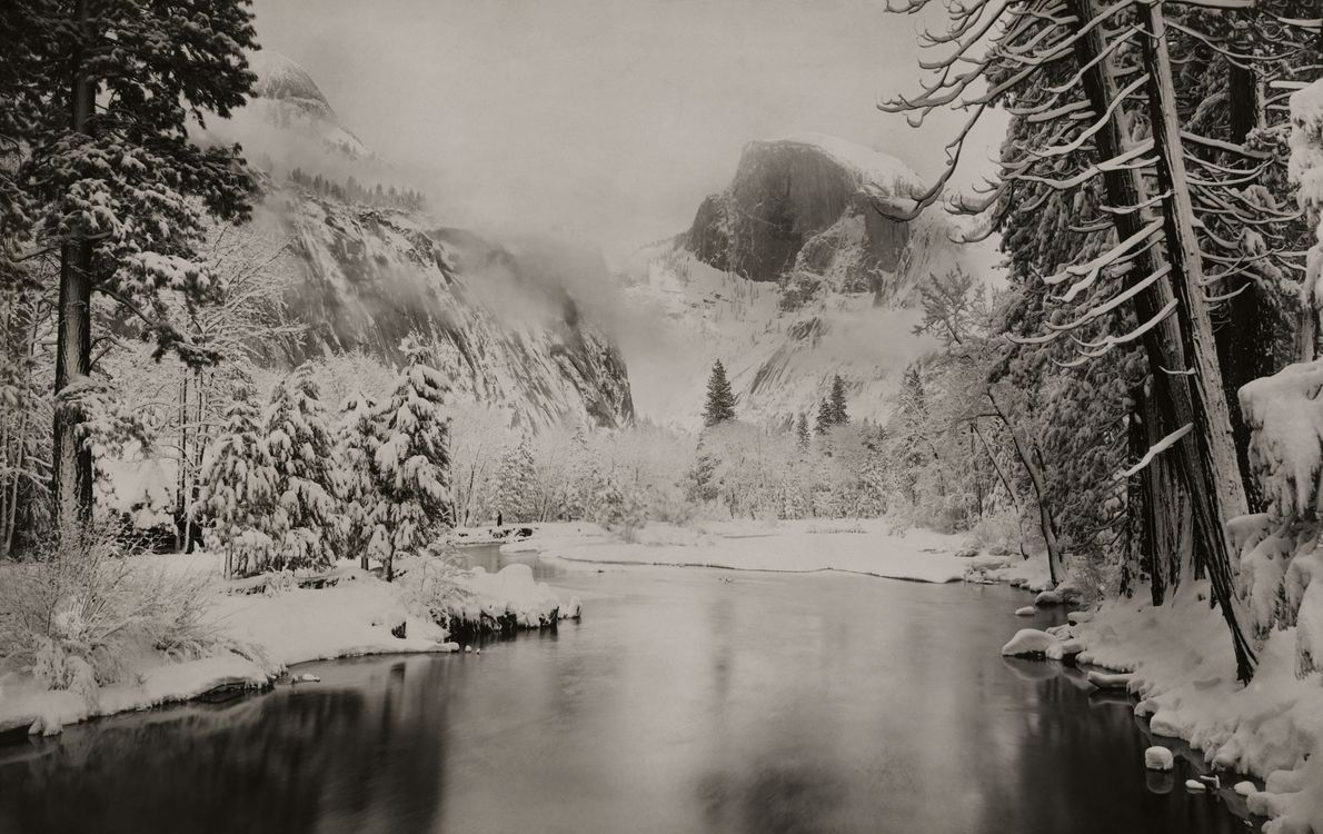 """Snow envelops Half Dome in this 1922 photo. It was declared """"perfectly inaccessible"""" in an 1865 ..."""