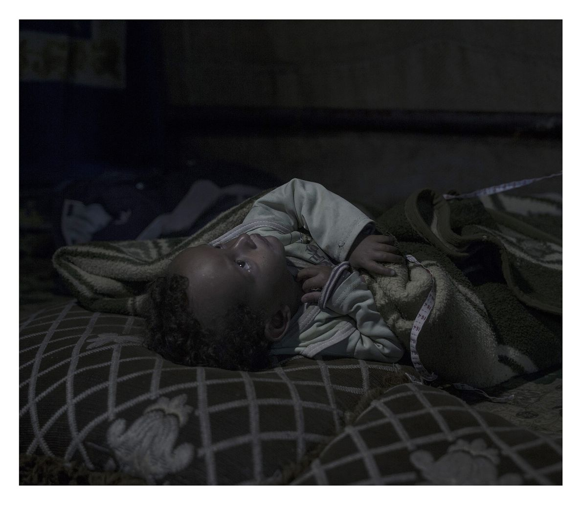 Amir was born a refugee. Although he is almost two years old, his mother says he ...