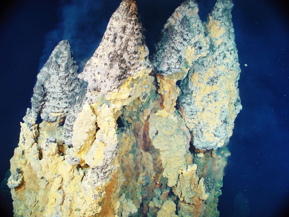 Superheated water laden with metals like iron, copper, and zinc sulfide builds up towering chimneys in ...