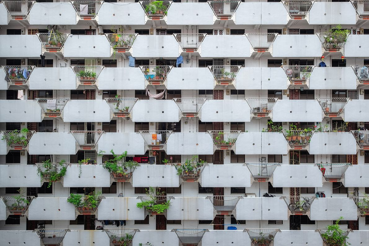 A view of a Singaporean apartment building gives a glimpse into the lives of its residents. ...