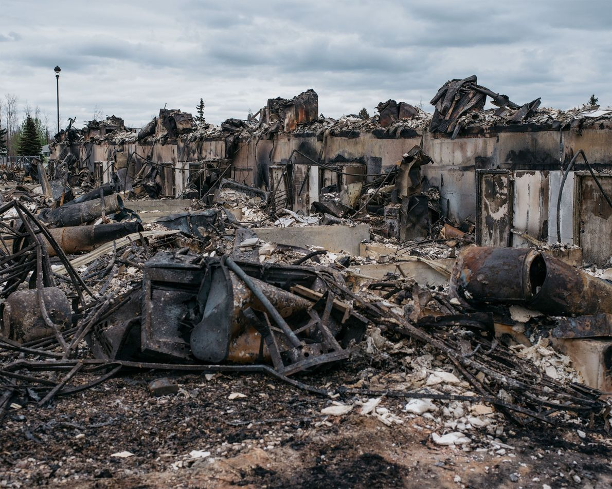 These charred and twisted remnants are all that's left of an apartment building in the Abasand ...