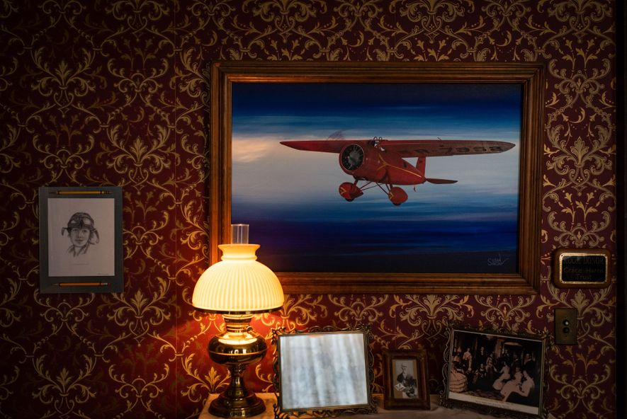 A painting of the plane that Amelia Earhart called the 'little red bus'—the Lockheed Vega 5B ...