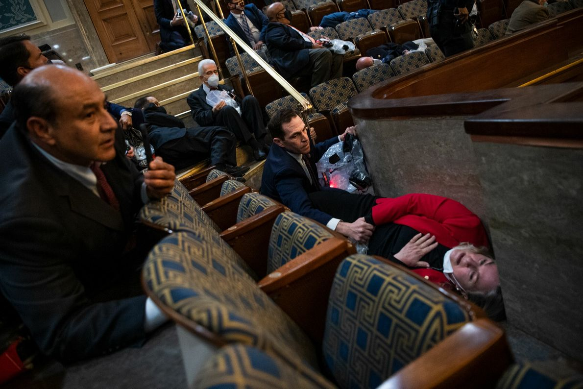 Colorado Representative Jason Crow comforted Pennsylvania Representative Susan Wild while taking cover as insurgents disrupted the ...