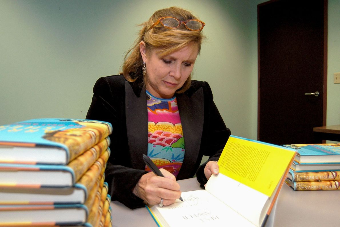 Carrie Fisher signs copies of her book 'The Best Awful', published in 2004. The book was ...