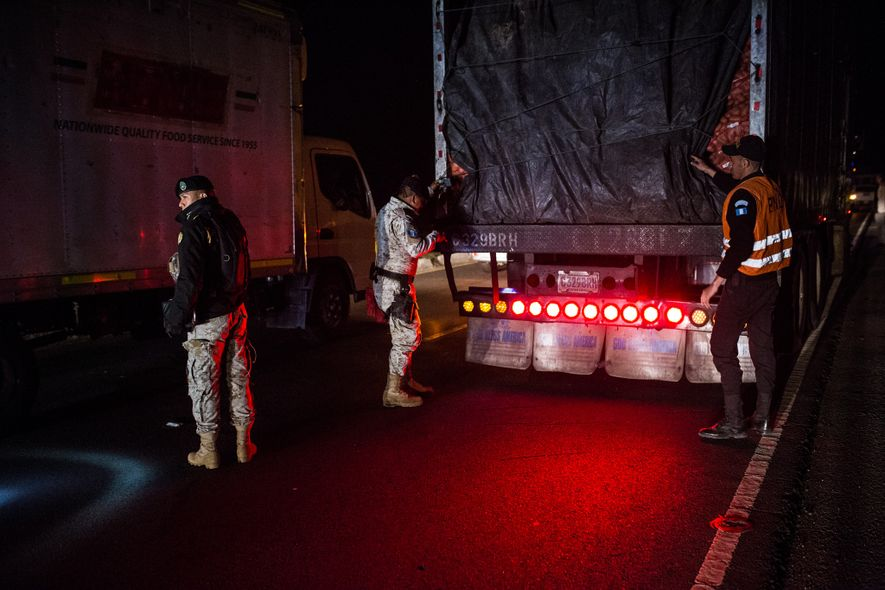 Agents from the national police and environmental police inspect a truck outside Sololá, at one of ...