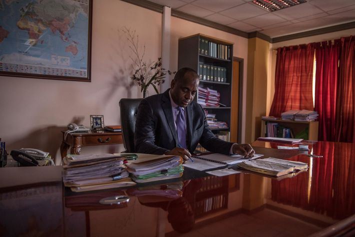 Eight months after Hurricane Maria, Roosevelt Skerrit, Dominica's prime minister, reviews paperwork in his office in ...