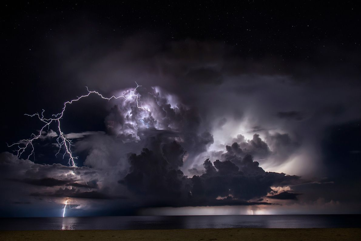 Positive lightning leaps from a thunderhead over the Atlantic Ocean off the coast of Palm Beach, ...