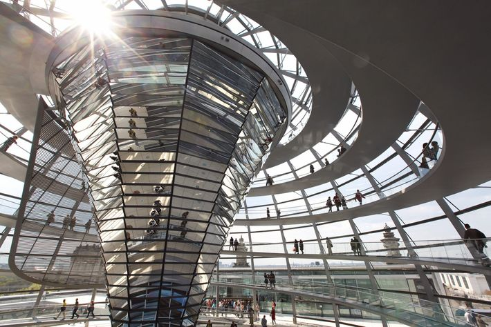 Reaching for the glass ceiling, 2.5 million annual visitors spiral up the modern dome capping Berlin's ...