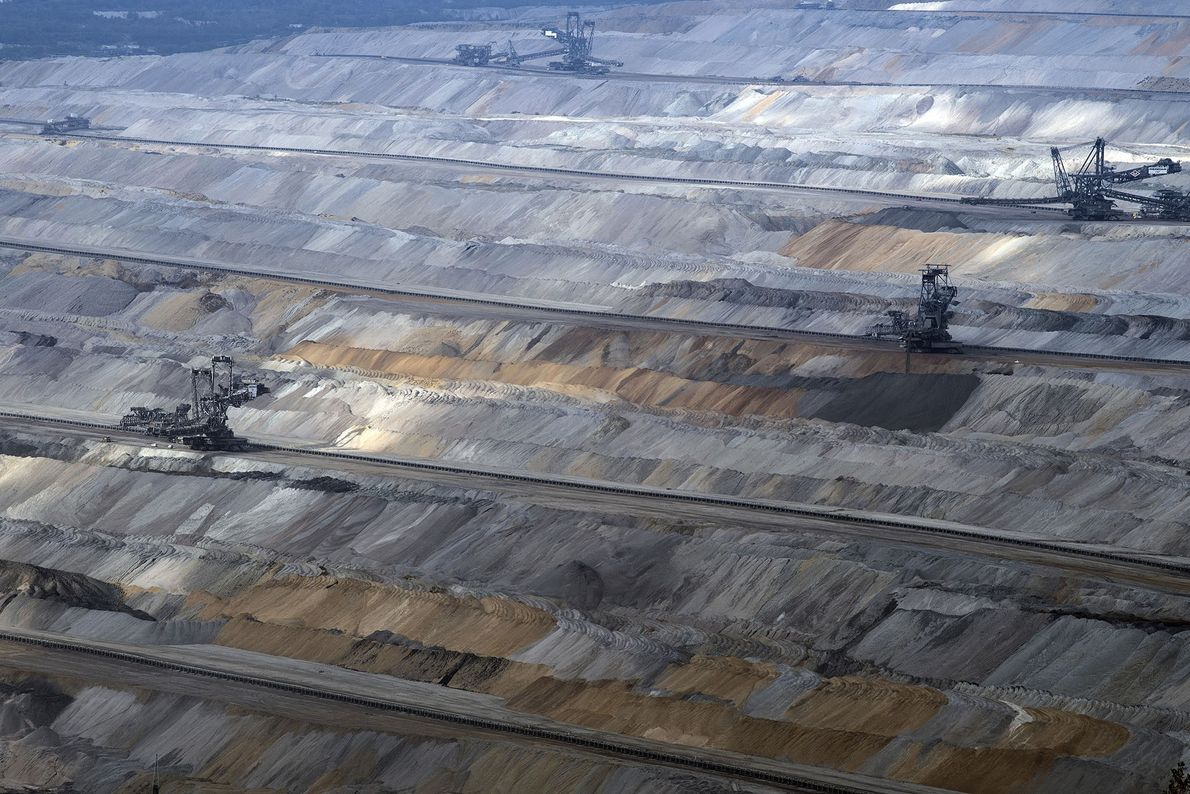 Mining continues over the remaining forest.