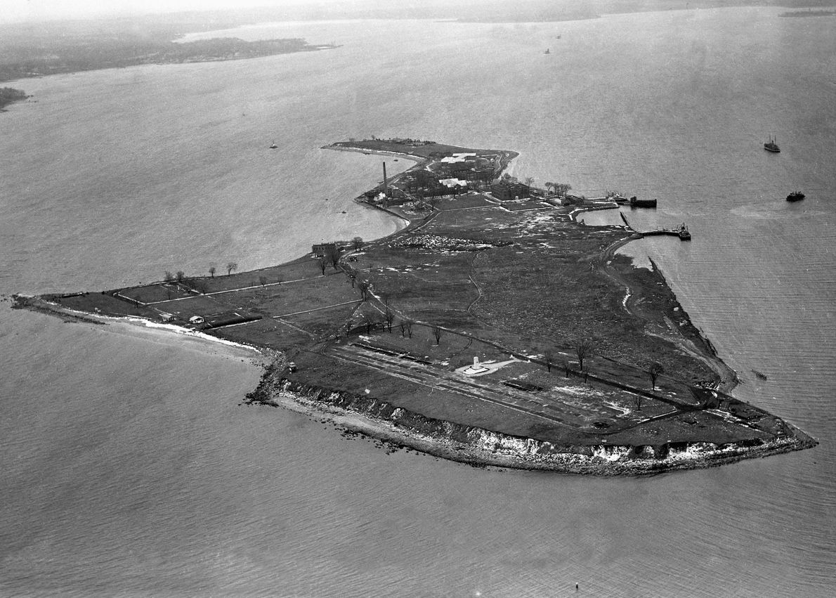 This 1950 aerial photo shows a 30-foot-tall white tower, a monument built by prisoners to mark ...