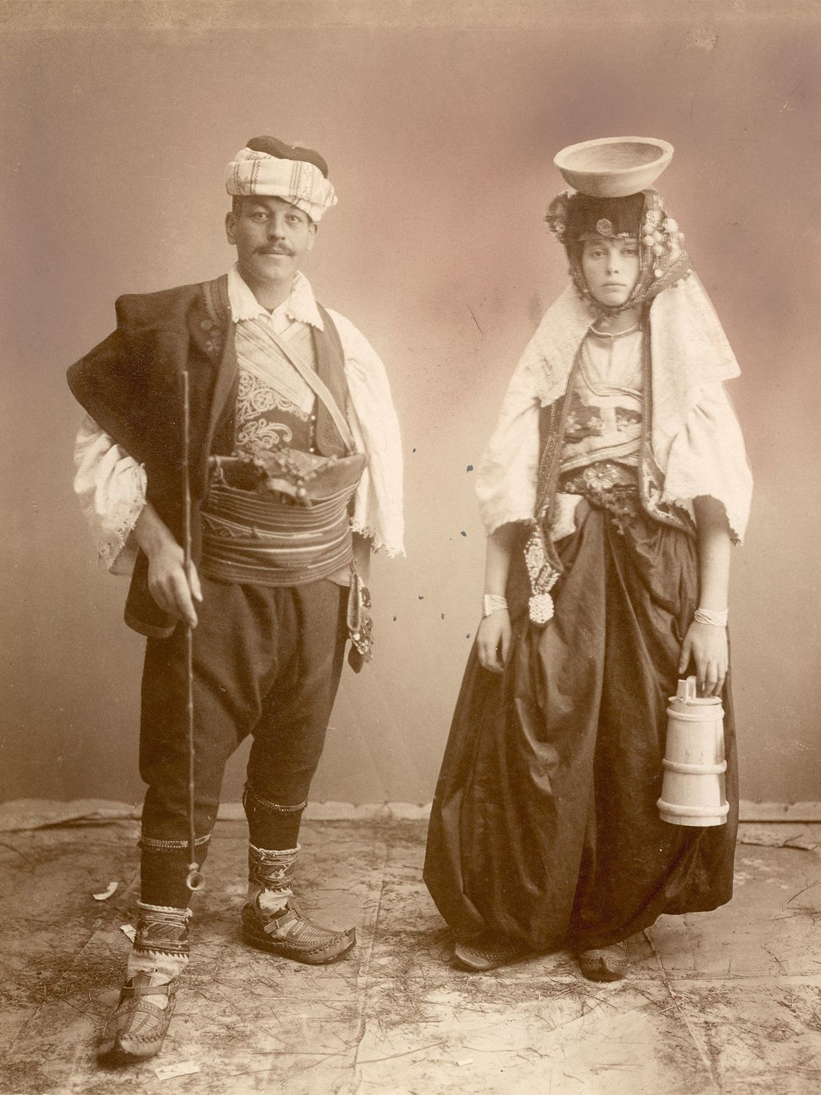 A young Serbian couple in Bosnia is elegantly dressed in elaborate clothing, including a bowl-shaped hat ...