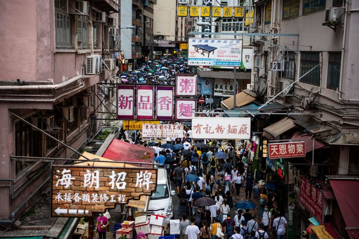 People march in protest against the national security law in Wan Chai, Hong Kong, on July ...
