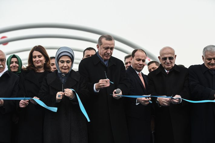 Turkish President Recep Tayyip Erdogan (C), his wife Emine Erdogan (3rdL), and Turkish Prime Minister Binali ...