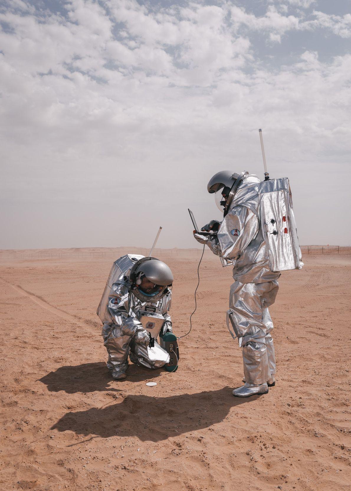 Analog astronauts Carmen Köhler and Iñigo Muñoz Elorza conduct an Italian Space Agency experiment to test ...