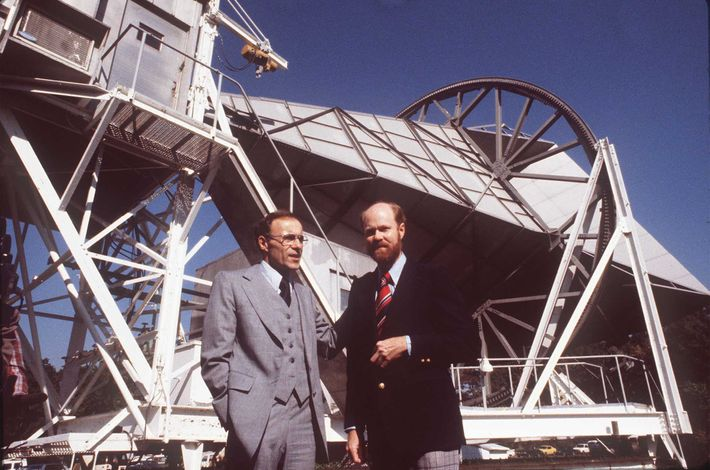 Physicists Robert W. Wilson (right) and Arno Penzias stand in front of the radio antenna they ...