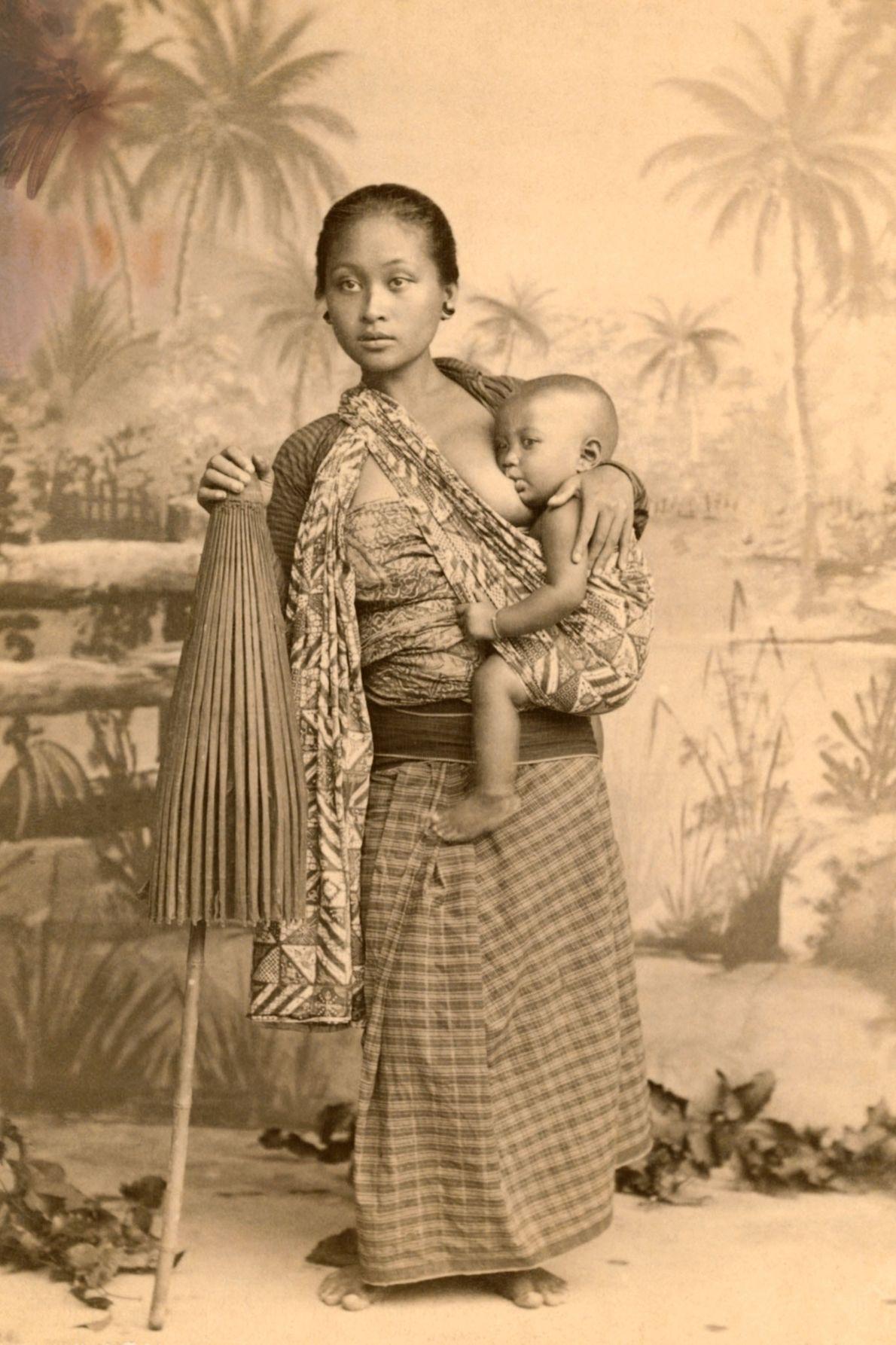 A Javanese mother nurses her child on Java Island, Indonesia.