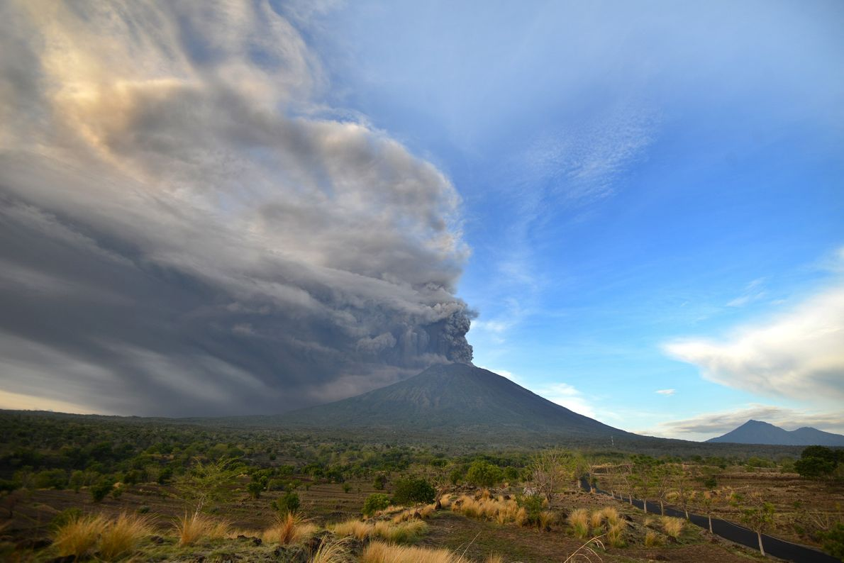 Ash-filled clouds rise from Mount Agung on Sunday.