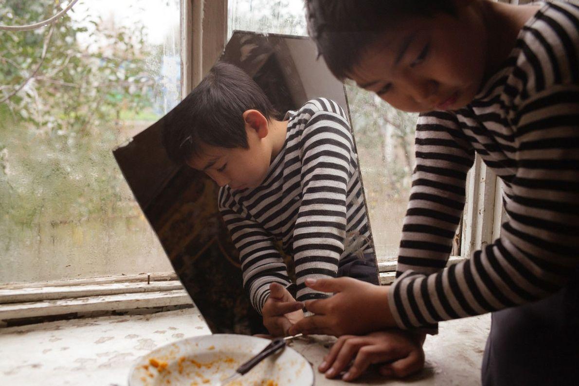 Alijan Imanbaev at home in Semey, Kazakhstan. Alijan suffers from epilepsy and learning difficulties.