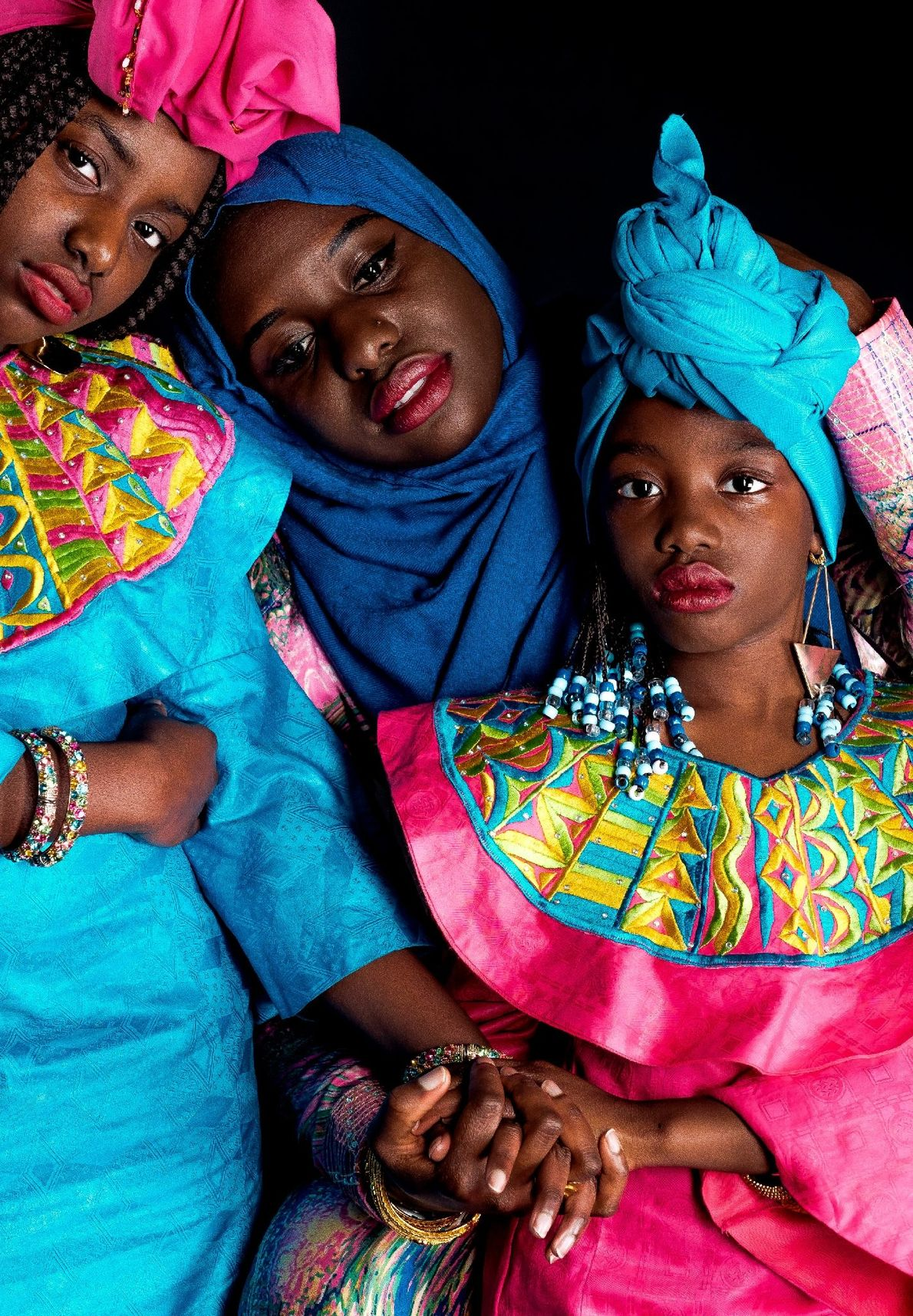 Ndeye Diop, center, and her daughters sit for a portrait by Your Shot photographer Edrece Stansberry. ...