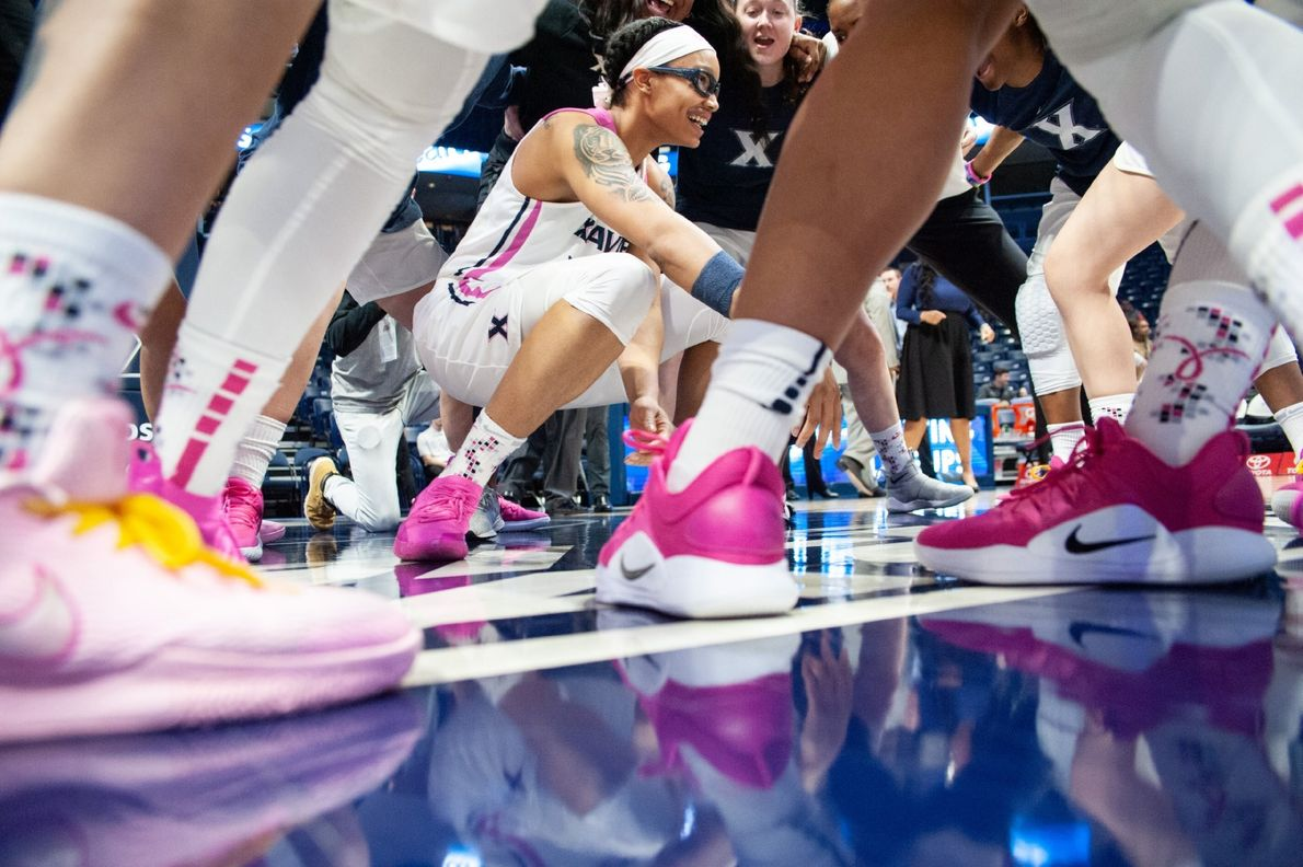 """""""Players from the Xavier University Women's basketball team circle prior to the start of their game ..."""