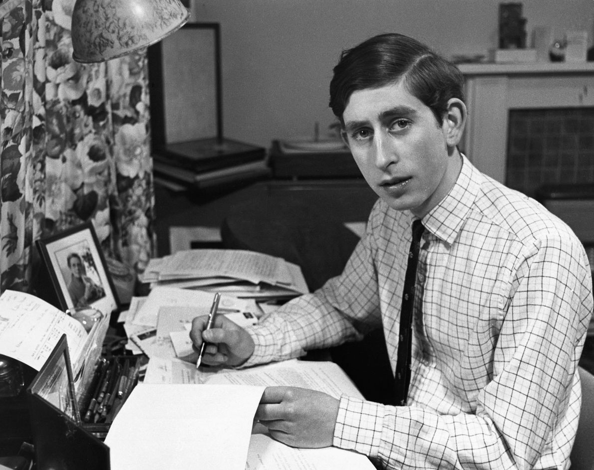 Prince Charles at work in his room as an undergraduate at Trinity College, Cambridge.