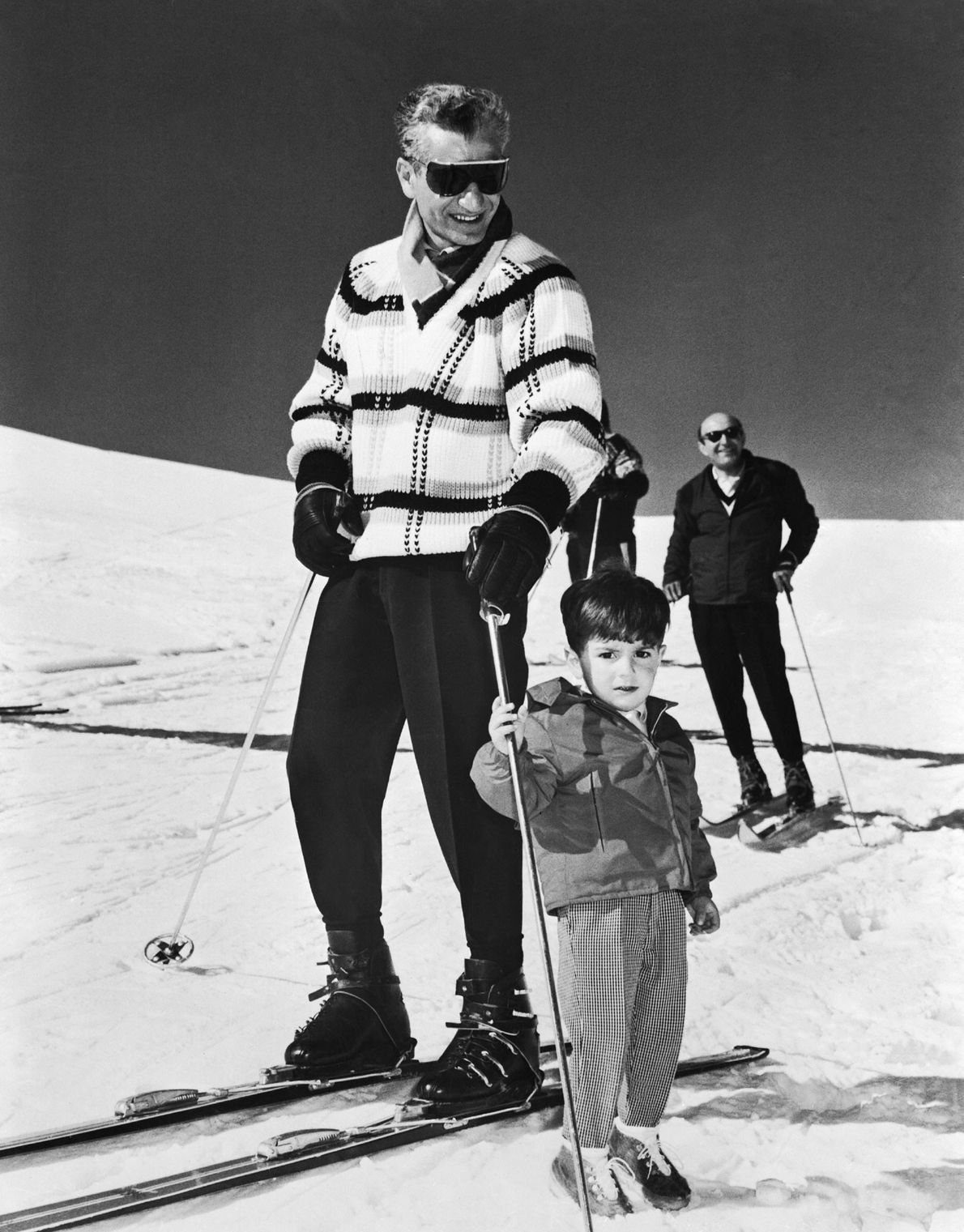Iranian Shah Mohammad Reza Pahlavi and his son ski nearly 40 miles south of Tehran in ...