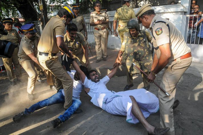 Indian police take men into custody as they march on the office of the Kerala's Inspector ...