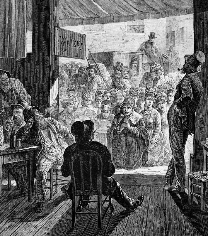 Women singing hymns at the door to a saloon, praying for the conversion of drinkers, in ...