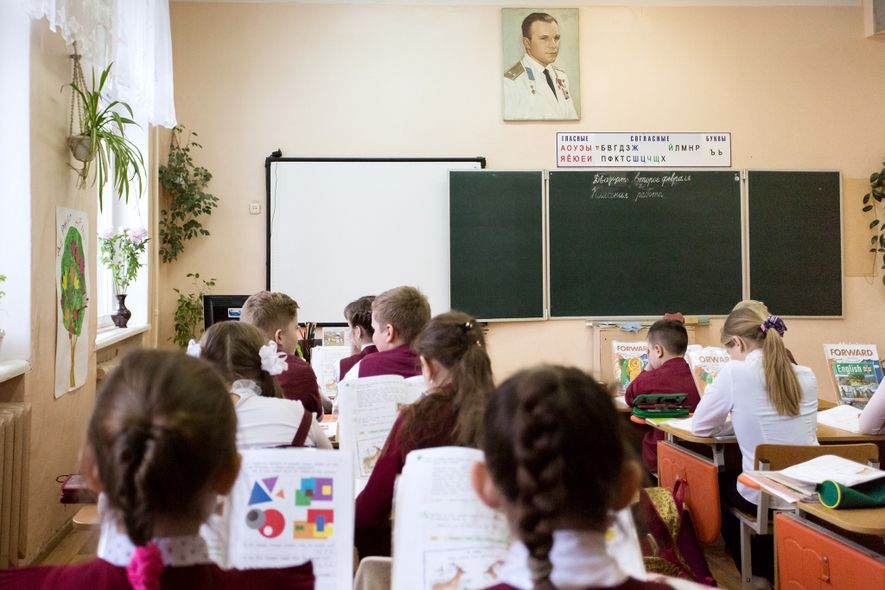 Children sit in a classroom at a town school named after Yuri Gagarin.