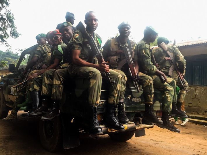 Congolese soldiers and Okapi park rangers accompany the bodies of those killed by rebels while guarding ...